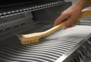 62028-grill-brush_in_use_napoleon_grills_jpg